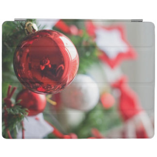 Close up of red ball on Christmas tree iPad Cover