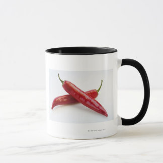 Close up of red chili peppers mug