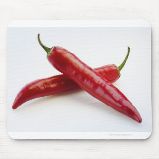 Close up of red chili peppers on white mouse mat