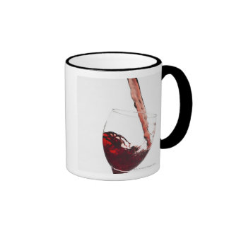 Close up of red wine being poured into glass on ringer mug