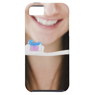 Close-up of smiling young woman holding case for the iPhone 5