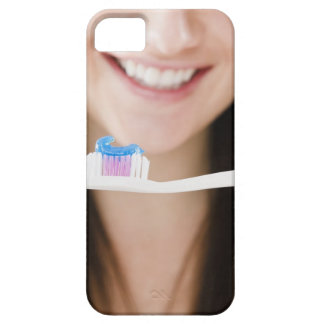 Close-up of smiling young woman holding iPhone 5 case