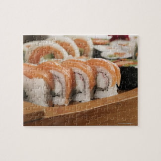 Close-up of sushi in a platter puzzles