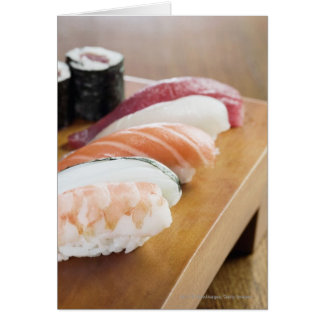 Close-up of sushi on a table card