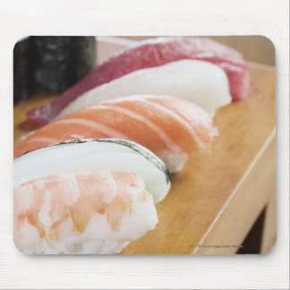Close-up of sushi on a table mouse pad