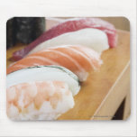 Close-up of sushi on a table mouse pads