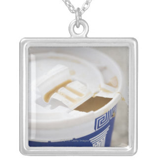 Close up of take out coffee silver plated necklace