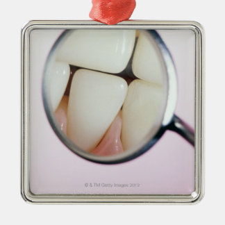 Close-up of teeth reflected in dental mirror christmas ornament