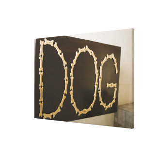 Close-up of text DOG made with dog biscuits on a Canvas Print