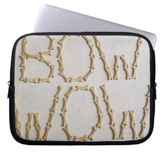 Close-up of texts BOW WOW made with dog biscuits Laptop Sleeve