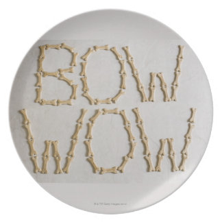 Close-up of texts BOW WOW made with dog biscuits Plate