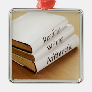 close-up of three books on a wooden surface christmas ornament
