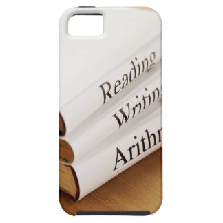 close-up of three books on a wooden surface tough iPhone 5 case