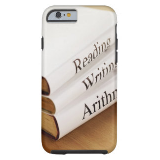 close-up of three books on a wooden surface tough iPhone 6 case