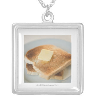Close up of toasts with butter on plate pendants