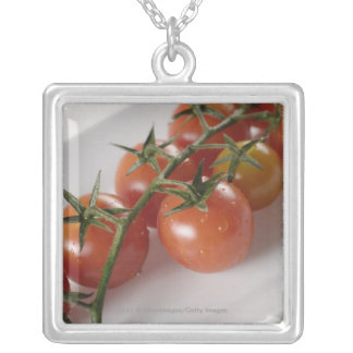 Close-up of tomatoes on a tray silver plated necklace