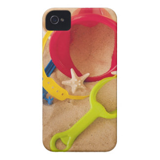 Close up of toys on sand iPhone 4 case