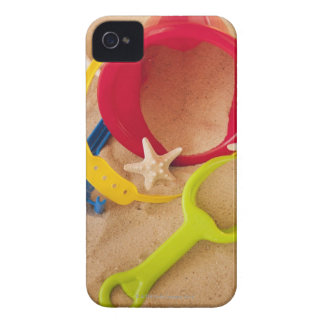 Close up of toys on sand iPhone 4 cover