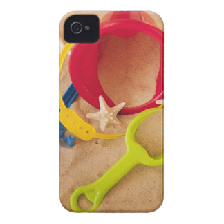 Close up of toys on sand iPhone 4 covers