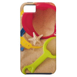 Close up of toys on sand iPhone 5 cases
