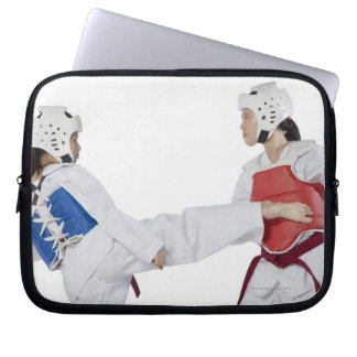 Close-up of two young women practicing laptop sleeve