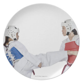 Close-up of two young women practicing party plates