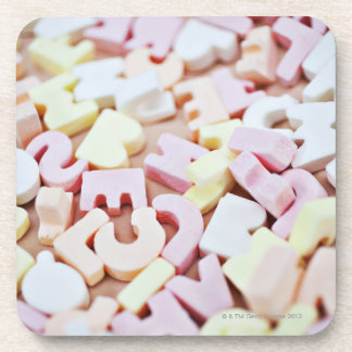 Close up of vibrant candy alphabet drink coaster