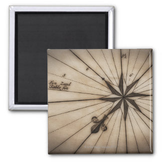 Close up of wind rose on antique map square magnet