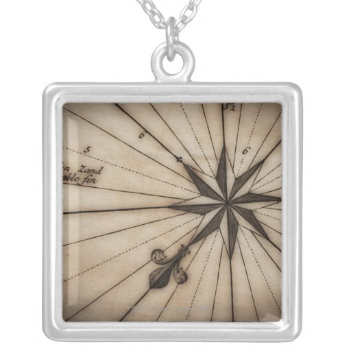 Close up of wind rose on antique map square pendant necklace