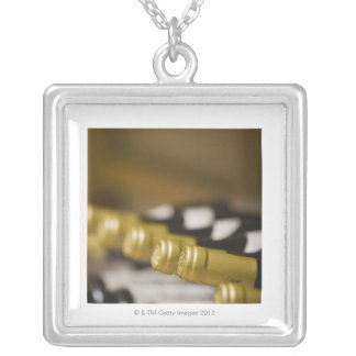 Close up of wine bottle tops silver plated necklace