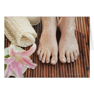 Close-up of womans feet having spa treatment cards