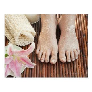 Close-up of womans feet having spa treatment postcard