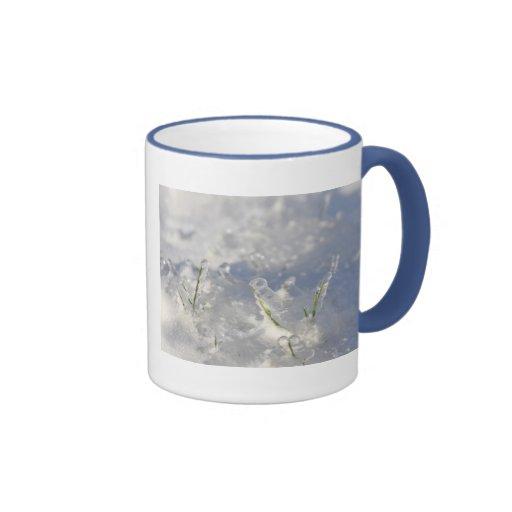 Close-up on green grass stems very iced coffee mugs