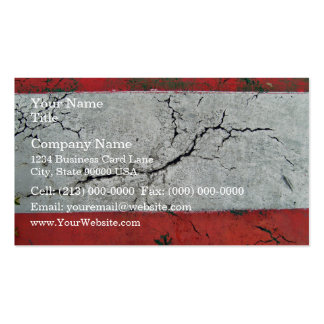 Close-up shot of cracked road with alternating bar pack of standard business cards