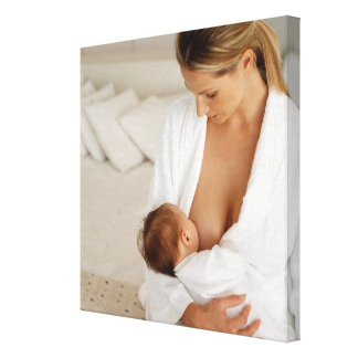 Close up view of a mother breastfeeding her baby canvas print
