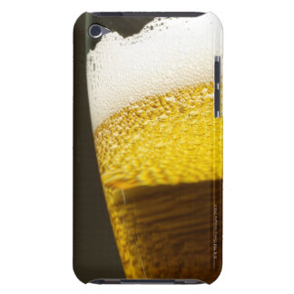 Close up view of beer bubbles and foam in a iPod touch case