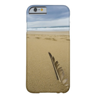 Close-up view of bird feather in beach sand, barely there iPhone 6 case