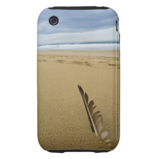 Close-up view of bird feather in beach sand, tough iPhone 3 case