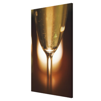 Close-up view of champagne glass stretched canvas print