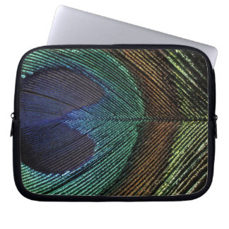 Close up view of eyespot on male peacock feather laptop sleeve