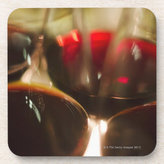 Close-up view of red wine glasses coaster