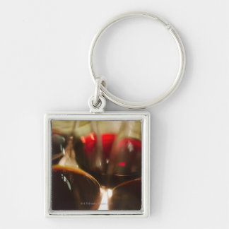 Close-up view of red wine glasses key ring