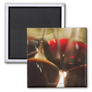 Close-up view of red wine glasses magnet