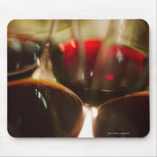 Close-up view of red wine glasses mouse pad