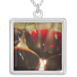 Close-up view of red wine glasses silver plated necklace