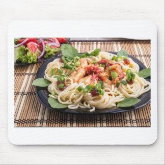 Closeup black plate with spaghetti mouse pad