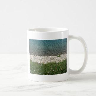 Closeup of a crystal clear alpine lake basic white mug