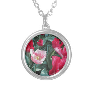 Closeup of colorful tulips with droplets in spring round pendant necklace