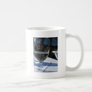 Closeup of glass with white wine basic white mug