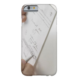 Closeup of hands signing prescription barely there iPhone 6 case